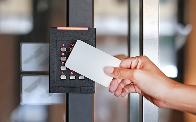 Hand Holding Card to Access Control Systems in Miramar, FL