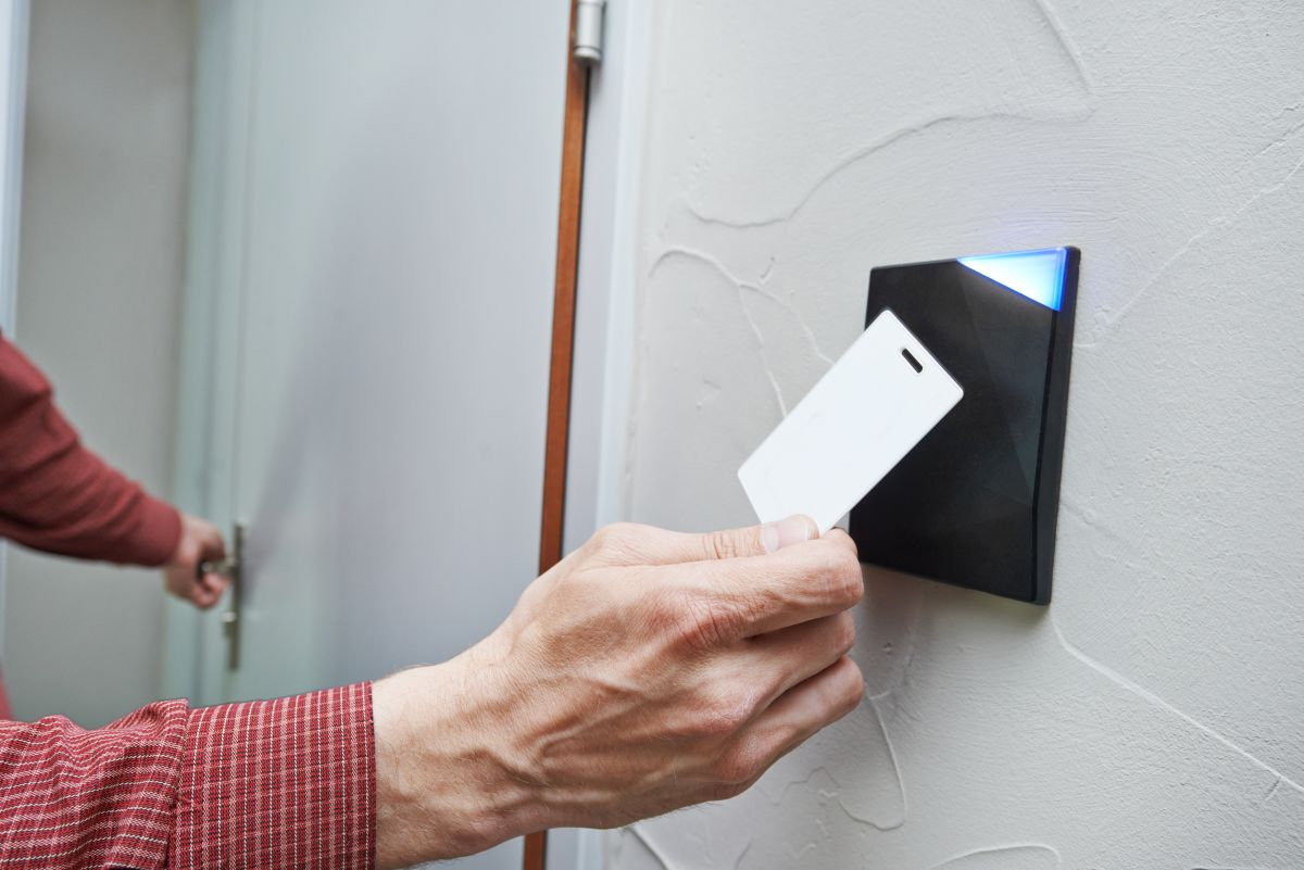 Hands Holding Key to Access Control Systems in Pompano Beach, FL