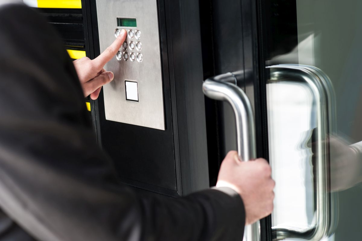 Man Opening Door with Access Control Systems in Pompano Beach, FL